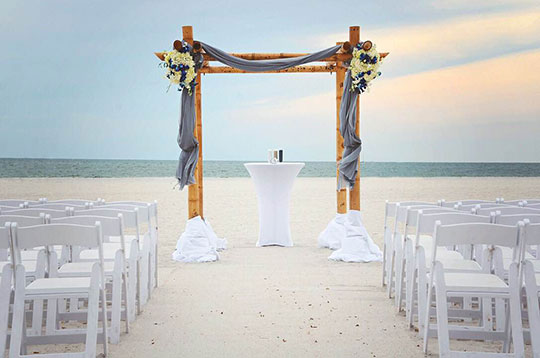 wedding arch on the beach at Sirata